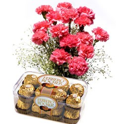 Bunch of 12 pink carnations with a box of chocolates.