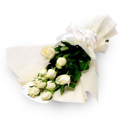Bunch of 10 white roses wrapped in white colour paper.