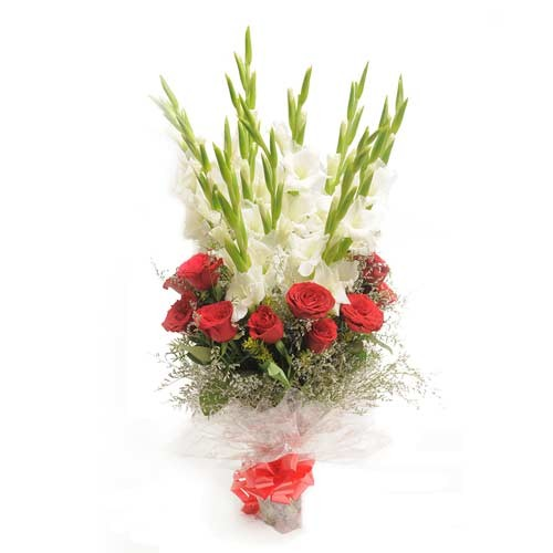 Bunch of red roses and white gladioli.