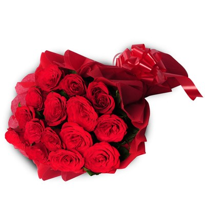 Bunch of 15 Red Roses wrapped in red paper with ribbon