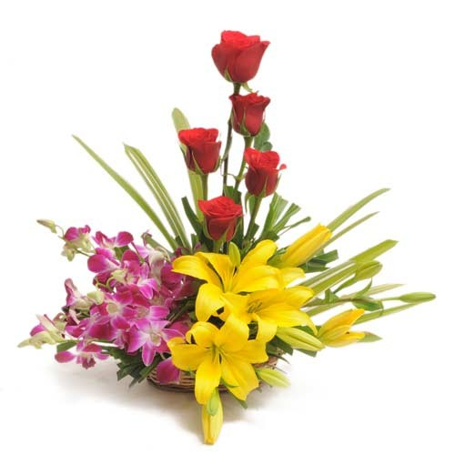 Red roses, purple orchids and yellow lilies in a basket.