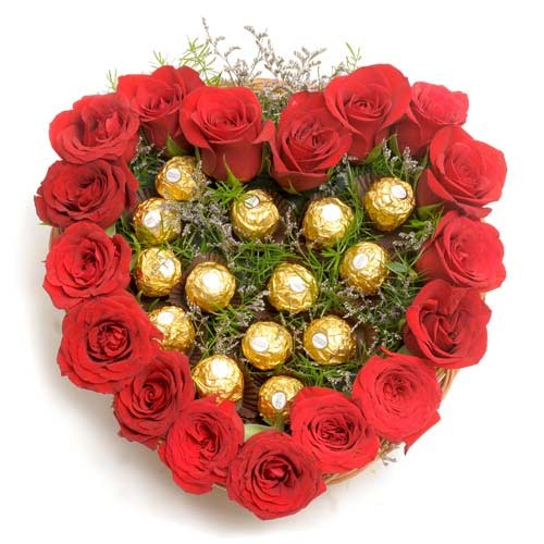 Red roses and ferrero rochers in a heart shaped basket.