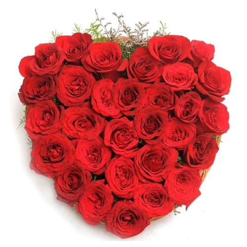 30 red roses arranged in a heart shaped basket