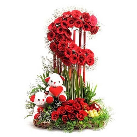 Basket of 50 red roses, soft toys and chocolates.