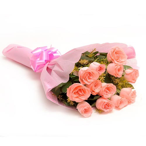 Bunch of 12 fresh baby pink roses wrapped in pink paper.