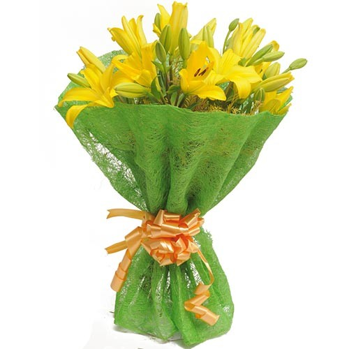 Bunch of yellow asiatic lilies wrapped in green paper.