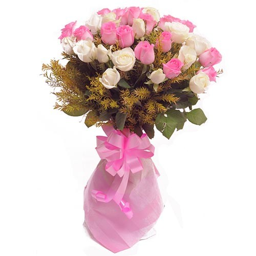 Bunch of pink and white roses mixed with green fillers.