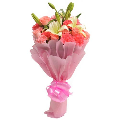 Bunch of pink carnations, pink roses & white lilies.