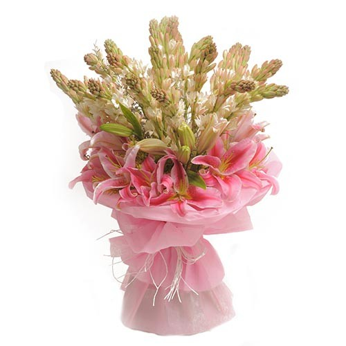 Bunch of pink oriental lilies with tube roses and green fillers.