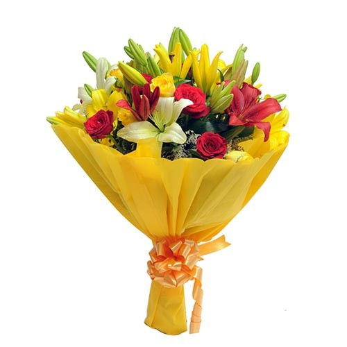Classic bunch of yellow and red roses and asiatic lilies.