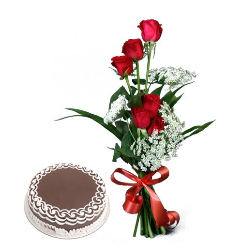 Bunch of red roses with a chocolate cake.