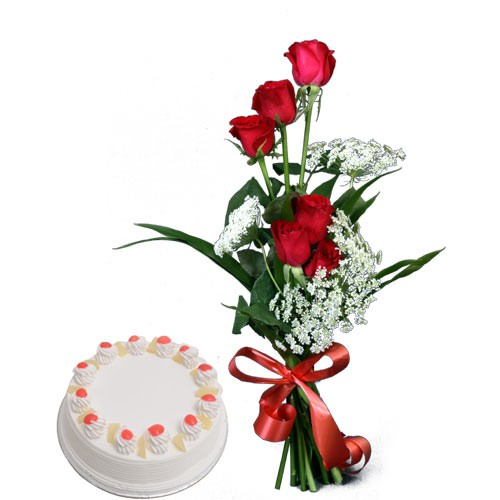 Bunch of red roses with pineapple cake.