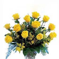 Bunch of 12 yellow roses with seasonal fillers.