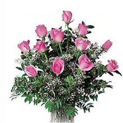 Bunch of 12 pink roses with seasonal fillers.