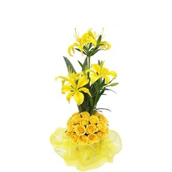Charming bunch of yellow roses and  lilies.