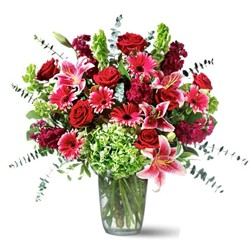 Bunch of 12 red seasonal flowers with green fillers.