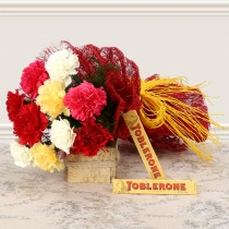 10 mix colour carnations with 2 Toblerone bars