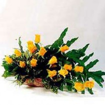 15 yellow roses set in a cane basket with fillers