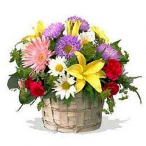 24 seasonal flowers arranged in a cane basket
