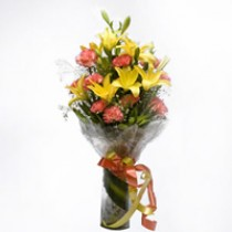 Glass vase arrangement of 4 yellow lilies and 10 orange carnations.