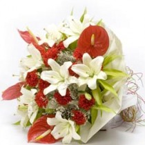 Bunch of white lilies with red anthuriums & carnations.