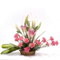 Set of 15 pink carnations and 4 white lilies arranged in a basket
