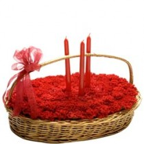 40 red carnations arranged in a basket with 3 candles