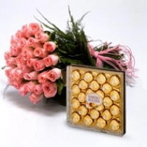 Pink roses with a box of ferrero rocher chocolates.