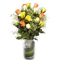 15  colourful roses with fillers in a glass vase.