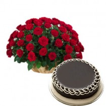 Basket of 50 red roses with a chocolate cake.