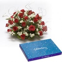 Basket of 15 roses with a box of chocolates.