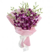 Bouquet of 9 purple orchids in a baby pink wrapping.