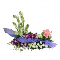Basket arrangement of white and pink roses with purple orchids and tube roses