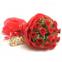 15 long stem red roses with a box of Ferrero Rocher chocolates.