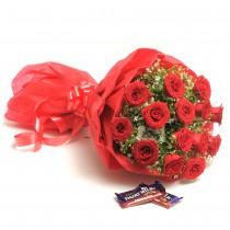 Bunch of 15 long stem red roses with chocolates.