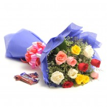 Bunch of 12 long stem Mix colour roses in a paper packing with 2 Fruit N Nut Chocolates (42gm each).