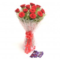 12 long stem red roses with chocolates.