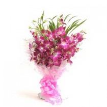 Bunch of purple orchids with green fillers.