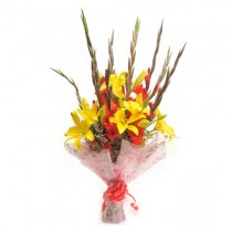 Bunch of red gladioli and  yellow lilies.