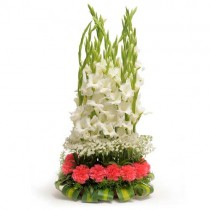 15 pink carnations and 8 white gladioli arranged in a basket