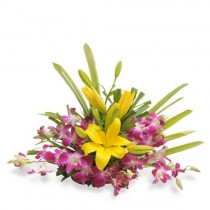 6 purple orchids and 2 yellow asiatic lilies arranged in a basket