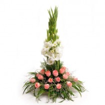 20 pink roses and 10 white gladioli set in a basket.
