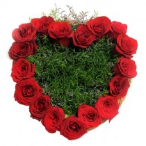 17 red roses with green fillers set in a heart shaped basket