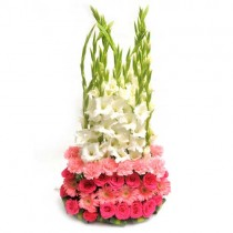 Basket arrangement of pink roses, carnations and gerberas with white gladioli
