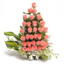 Pretty basket arrangement of 32 pink roses with 4 white orchids