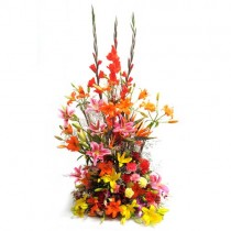 Colourful basket arrangement of 52 exotic flowers