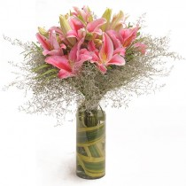 Glass vase arrangement of 6 pink oriental lilies.
