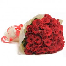 Exquisite bunch of 50 red roses wrapped in white.