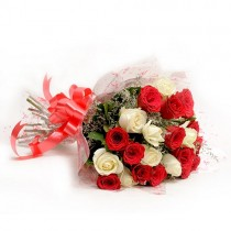Bunch of 25 red and white roses with white fillers.