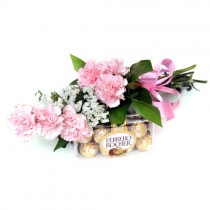 Baby pink carnations & a box of ferrero rocher chocolates.